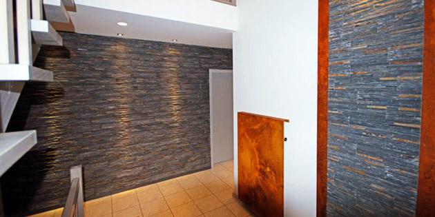 Bei uns treffen moderne Wände auf zeitlosen Naturstein